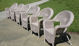 Old fashion wicker chairs. Old fashioned wicker chairs used as part of seating for a wedding stock photo