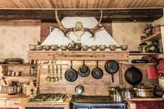 Old fashion wooden kitchen. Rustic style kitchen with pots and pans Royalty Free Stock Photography