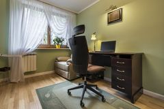 Old fashion working room. With modern chair Royalty Free Stock Photography
