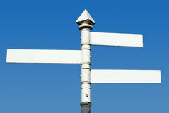 Old fashioned 3 way blank direction signpost. Old fashioned English 3 way blank direction signpost royalty free stock image