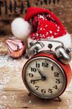 Old-fashioned alarm clock and red Christmas cap Stock Image
