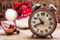 Old-fashioned alarm clock and red Christmas cap Stock Photo