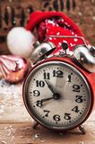 Old-fashioned alarm clock and red Christmas cap Stock Photography