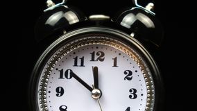 Old fashioned alarm clock ringing at noon.  stock footage
