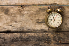 Old fashioned alarm clock on wooden background Royalty Free Stock Image