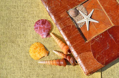 Old-fashioned album, colored seashells on the sacking Stock Photo