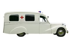 Old fashioned Ambulance. Vintage old Ambulance, isolated on white. With clipping path Stock Photos