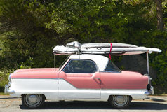 Old fashioned american automobile with surfboard in Vancouver. C Royalty Free Stock Photos
