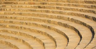 Old fashioned amphitheater made of stairs of stone stock photography