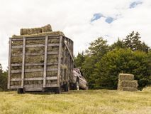 Wooden Hay Wagon Pulled by Truck in a Field royalty free stock images