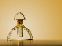 Old fashioned, antique perfume bottle, with gold top and backgro Stock Photography