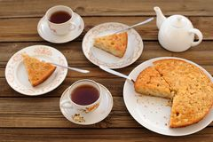 Old-fashioned apple pie with black tea. On wood board Royalty Free Stock Photos