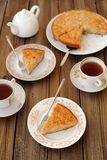Old-fashioned apple pie with black tea. On wooden background Stock Photo