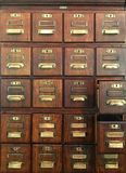 Old-fashioned archive, filing draws. - rows of small draws royalty free stock image