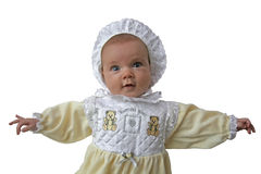 Old-fashioned baby. A baby with old-fashioned bonnet and dress royalty free stock photography