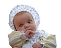 Old-fashioned baby. A baby with old-fashioned bonnet and dress royalty free stock photos
