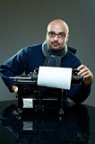 Old fashioned bald writer in glasses Royalty Free Stock Images