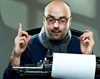 Old fashioned bald writer in glasses Stock Photos