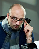 Old fashioned bald writer in glasses Stock Images