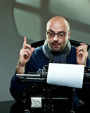 Old fashioned bald writer in glasses royalty free stock image