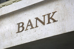 Old Fashioned Bank Sign. Old fashioned 'Bank' sign on a building exterior stock photo