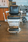Old fashioned barber's chair Royalty Free Stock Photos