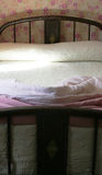 Old fashioned bed. Old-fashioned bed with pink linen stock photo