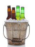 Old Fashioned Beer Bucket With Four Bottles Stock Images