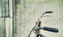 Old fashioned bicycle. The grey cement wall background and old-fashioned bicycle nostalgia time Stock Image