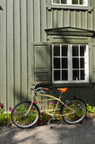 Old-Fashioned Bicycle Leaning Against Wall Stock Photography