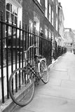 Old-fashioned bicycle in a quiet London Street Royalty Free Stock Photography