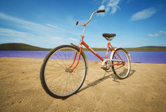 Old-fashioned bicycle on summer beach Stock Image