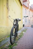 Old-fashioned bike on a street Stock Photo