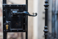 Old-fashioned black steel door handle close up Royalty Free Stock Images