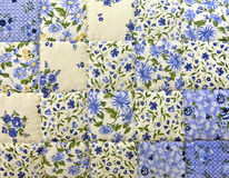 Old-fashioned blue floral print quilt. Close up of an old-fashioned blue floral printed quilted background Stock Photo