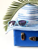 Old fashioned blue suitcase for travel and beach hat Royalty Free Stock Photography