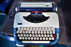 Old fashioned blue, white typewriter Royalty Free Stock Images