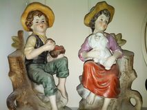Old fashioned boy and girl figurines Stock Photography