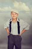 Old fashioned boy looking to the camera Royalty Free Stock Images