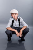 Old fashioned boy sitting Royalty Free Stock Images