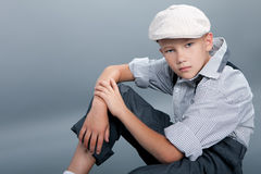 Old fashioned boy sitting Royalty Free Stock Photography