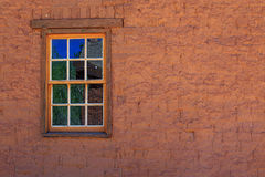 Old fashioned brick wall and window Stock Images