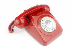 Old fashioned bright red telephone handset. Red old fashioned style telephone from 1970's royalty free stock photography