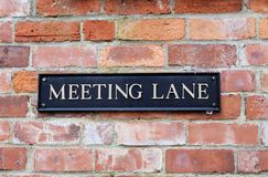 Meeting Lane old fashioned Street Sign stock images