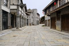 Old-fashioned buildings with brick facades along flagstone street. In cloudy afternoon,Qingyan town,Guiyang,China royalty free stock images