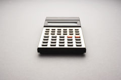 Old fashioned calculator on white background studio shot Royalty Free Stock Photos