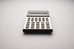 Old fashioned calculator on white background studio shot Royalty Free Stock Photos