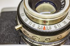 Old-fashioned camera and lens. Close up old-fashioned camera and lens stock photo