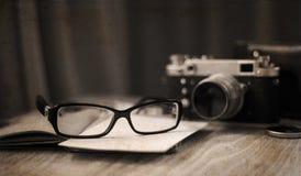 Old-fashioned camera and stylish glasses Stock Photo