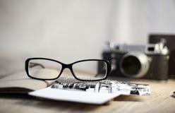 old-fashioned camera and stylish glasses Royalty Free Stock Photo